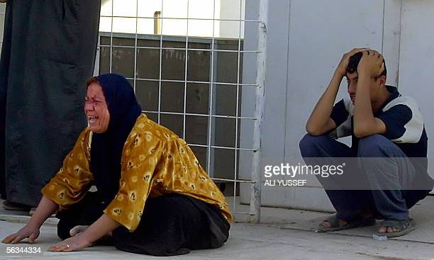 An Iraqi woman mourns outside the morgue of a local hospital in the restive city of Baquba northeast of Baghdad 06 December 2005 Bodies of a police...