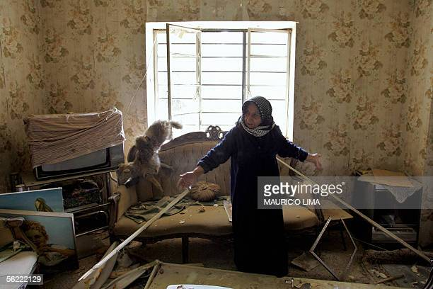An Iraqi woman reacts inside her destroyed living room at the site where two suicide bombers detonated explosivesladen cars near Al Hamra hotel that...