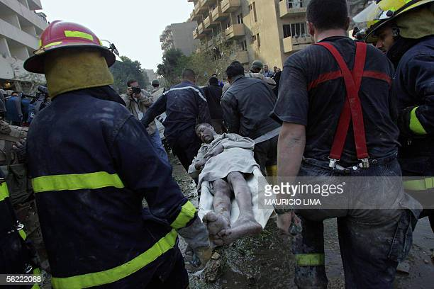 An Iraqi wounded man is evacuated by members of civil defense at the site where two suicide bombers detonated explosivesladen cars near Al Hamra...