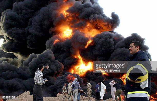 Black smoke billows from the site where an Iraqi pipeline was set ablaze near the village of Tari alBaghl west of the northern city of Kirkuk 20...