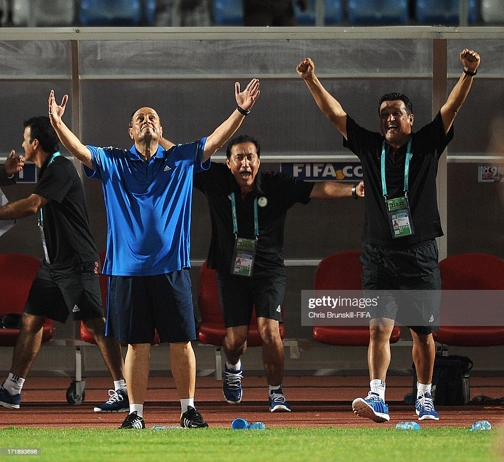 Iraq coach Hakeem Al Azzawi celebrates at full-time following the FIFA U20 World Cup Group E match between Iraq and Chile at Akdeniz University Stadium on June 29, 2013 in Antalya, Turkey.