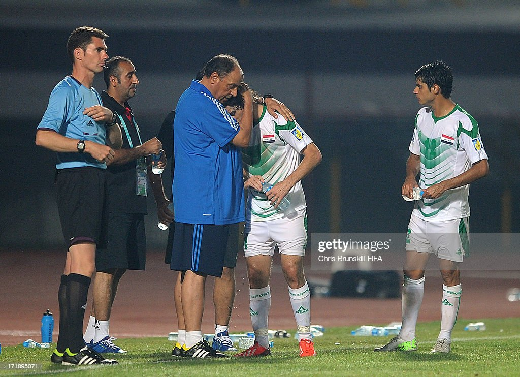 Iraq coach Hakeem Al Azzawi embraces Humam Tareq during the FIFA U20 World Cup Group E match between Iraq and Chile at Akdeniz University Stadium on June 29, 2013 in Antalya, Turkey.