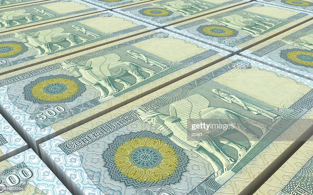 Iraq dinars bills stacks background. : ストックフォト