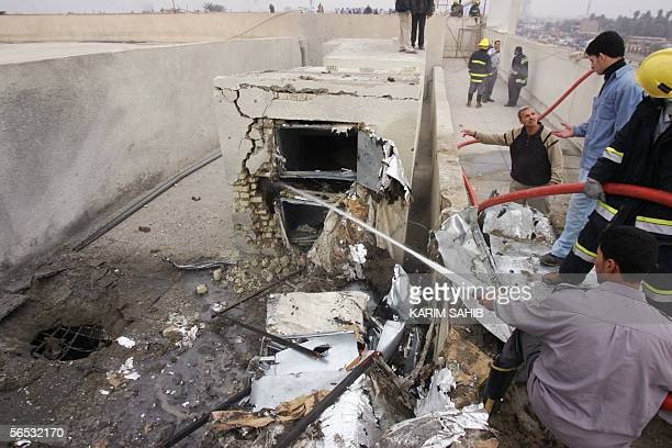 Fire fighters spray water after a mortar shell fell on the roof of the main Sunni Muslim Abdul Kader alGilani shrine in central Baghdad 06 January...