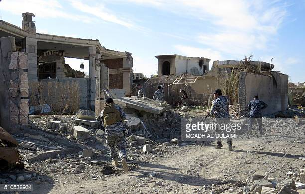 Iraq government troops remove bombs planted in houses and streets in Ramadi's Husseiba easten district on February 15 after retaking the city from...