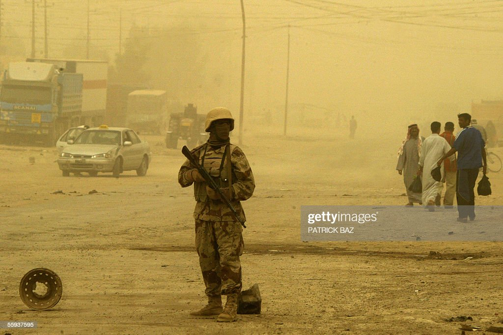 In the midst of a sand storm that engulfed Iraq an Iraqi army soldier mans a roadblock in the city of Fallujah, west of Baghdad 17 October 2005. More than 60 percent of the population returned to the city devastated by heavy combats between US marines and insurgents in November 2004. About 70 insurgents were killed in US air strikes in the Ramadi region of western Iraq, where five US and two Iraqi soldiers were killed in a weekend roadside bombing, the US military said today.