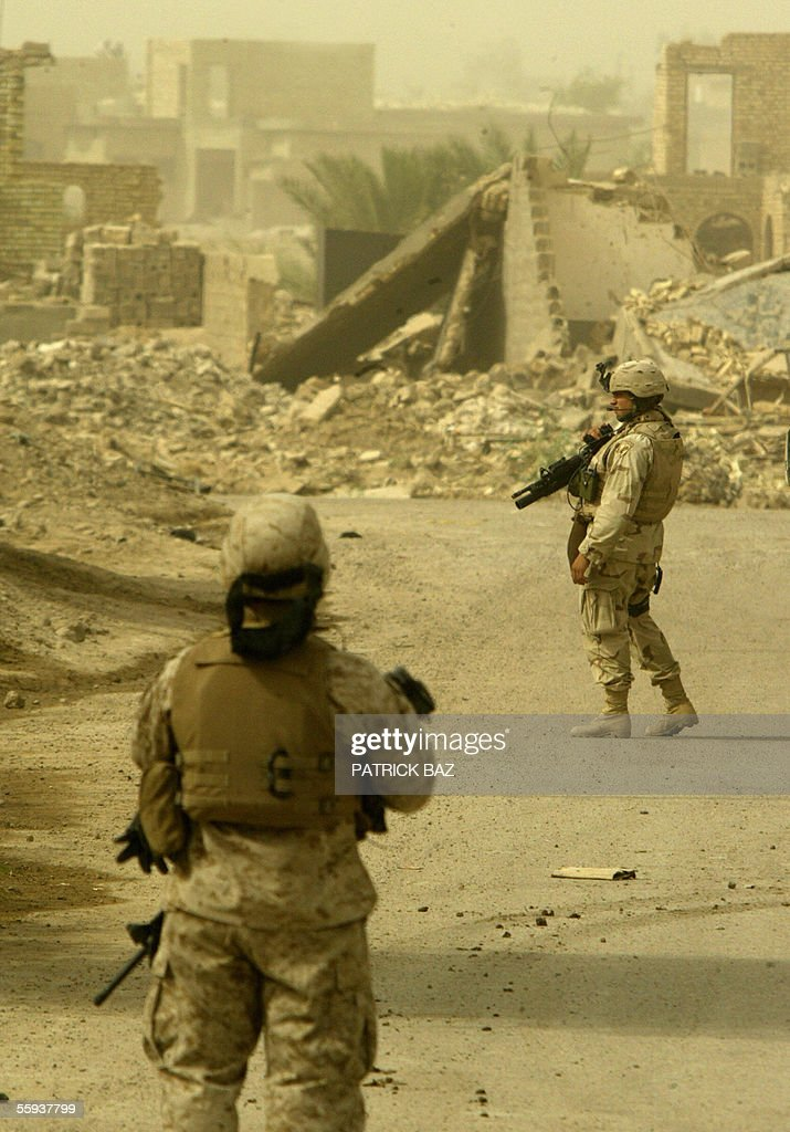 In the midst of a sand storm that engulfed Iraq US marines from the 6th Civil Affairs Group 2nd Marine Expeditionary Force (MEF) patrol the southern part of the city of Fallujah, west of Baghdad, 17 October 2005. More than 60 percent of the population returned to the city devastated by heavy combats between US marines and insurgents in November 2004. About 70 insurgents were killed in US air strikes in the Ramadi region of western Iraq, where five US and two Iraqi soldiers were killed in a weekend roadside bombing, the US military said today.