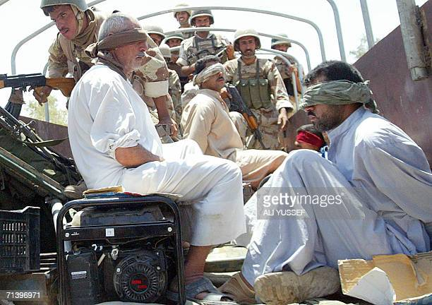 Iraqi Army Soldiers from the 2nd Battalion 2nd Iraqi Army Brigade guard detainees in the town of Muqdadiyah 08 July 2006 Iraqi forces arrested 70...