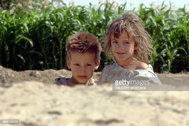 Iraqi children look at US soldiers patrolling in the city of Tikrit north of Baghdad 20 October 2005 Iraqi security forces have arrested a nephew of...