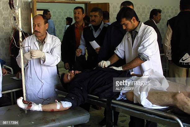 Iraqi doctors treat a wounded Iraqi policeman at a local hospital in the city of Baquba northeast of Baghdad 08 November 2005 Unknown gunmen attacked...
