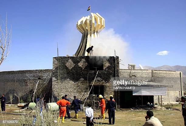 Iraqi fire fighters douse fire a memorial building, constructed to commemorate the victims of the 1988 gas attack in the Iraq northern Kurdish town...
