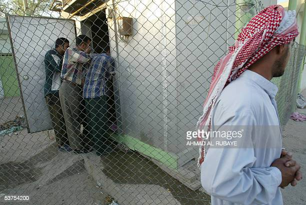 Iraqi men search for the bodies of relatives at the morgue of a hospital in Baghdad 01 September 2005 Thousands of grieving Iraqis were searching for...