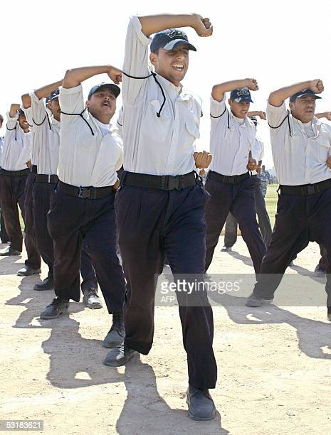 Iraqi policemen demonstrate their abilities during a training course in the holy city of Najaf, south of Baghdad, 02 July 2005. A suicide bomber blew...