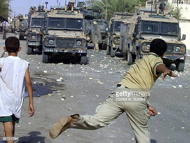 Iraqi protesters throw stones at British soldiers in the southern Iraqi city of Basra 19 September 2005 Iraqi police have detained two British...