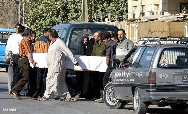 Iraqis carry the coffin of one of the bodyguards of Samir alBaghdadi a representative of Grand Ayatollah Ali alSistani at a local hospital in Baghdad...