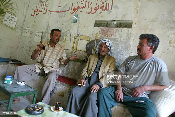 Iraqis drink tea in a local cafe in Madain 30 kilometers south of Baghdad 19 April 2005 Religious and civic leaders expressed fears of a conspiracy...