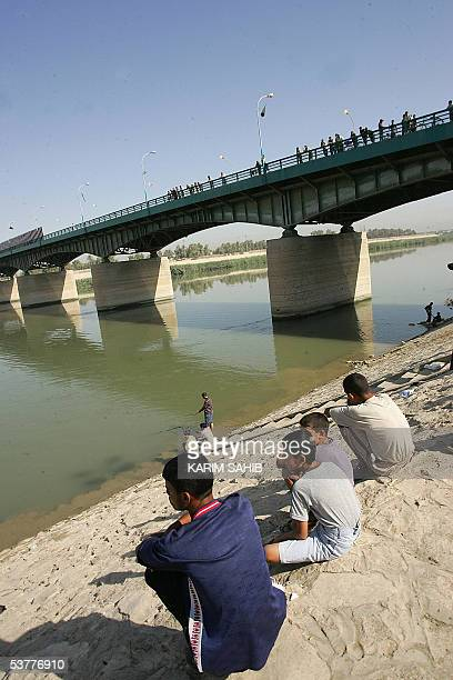Iraqis gather at a stampede site as others search for traces of their relatives in Baghdad 01 September 2005 Thousands of grieving Iraqis were...