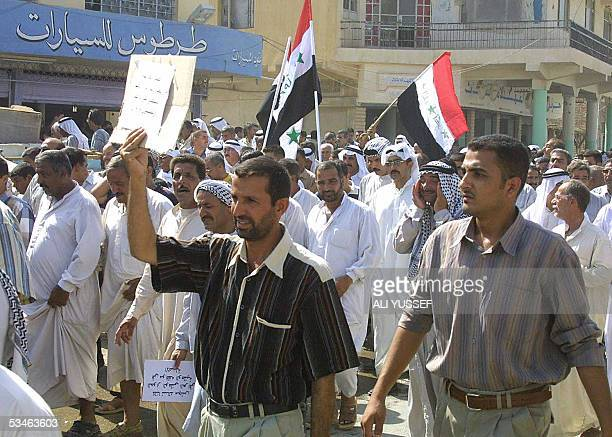 Iraqis protest in the streets of Baquba 60kms northeast of Baghdad 26 August 2005 against federalism and the new Iraqi constitution Some 50 people...