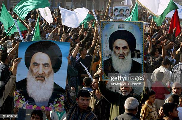 Iraqis raise the pictures of Grand Ayatollah Ali al-Sistani during a demonstration in Baghdad's poor neighborhood of Sadr city 14 December 2005 to...