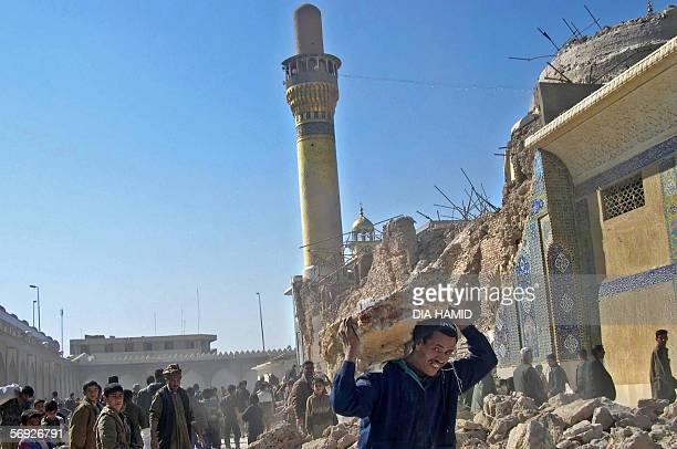 Iraqis work to clear the rubble from the destroyed holy shrine of al-Hadi in the northern city of Samarra, 23 February 2006. Gunmen have killed at...