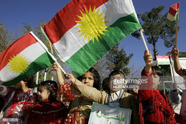 Kurdish children wave the Kurdish flag10 December 2005 in the northern city of Suleymaniya in northern Iraq More than 220 separate entities be they...