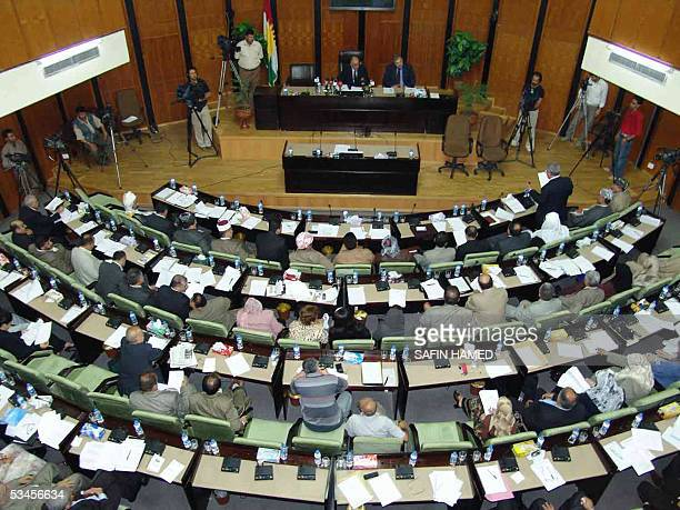 Kurdish MPs sit during a session of the Kurdistan's regional parliament in the northern city of Arbil 24 August 2005 Efforts to push through wartorn...