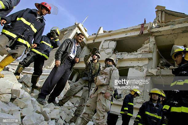 Members of Iraqi civil defense listens the safety procedures to clean the area from a US soldier from 464 Battalion 3rd Infantry Division as they...
