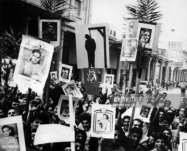 Iraq military coup d' etat July 14th 1958 overthrow reign king Faisal II Street demonstraters in Baghdad carry posters of military leader Abd al...