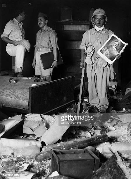 Iraq military coup d'etat July 14th 1958 overthrow reign king Faisal II Iraqi soldier within the sacked palace of crownprince Abdull Illah carrying a...