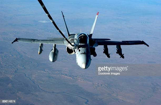 Iraq, November 26, 2004 - An F/A-18C Hornet receives fuel from a U.S. Air Force KC-10 Extender. Both aircraft are conducting missions over Iraq in support of Operation Iraqi Freedom.