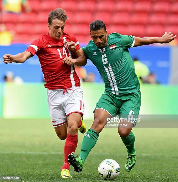 Iraq player Ali Adnan is marked by Denmark player Casper Nielsen during their Rio 2016 Olympic Games First Round Group A men's football match Denmark...