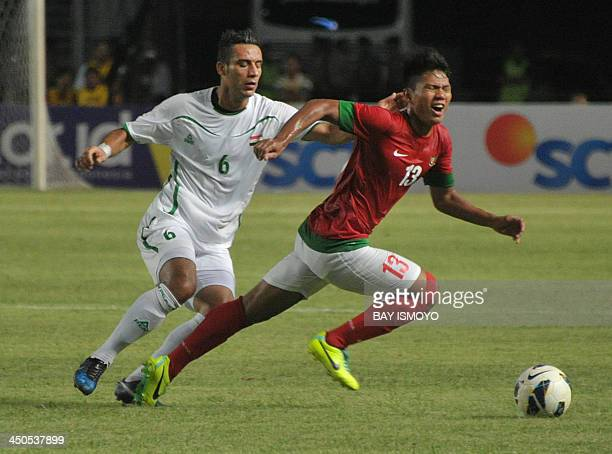 Iraq player Ali Adnan Kadhim fights for the ball against Indonesian Achmad Jufriyanto during their 2015 Asian Cup group C qualifying football match...