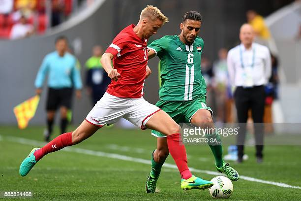 Iraq player Ali Adnan vies for the ball with Denmark player Kasper Larsen during their Rio 2016 Olympic Games First Round Group A men's football...