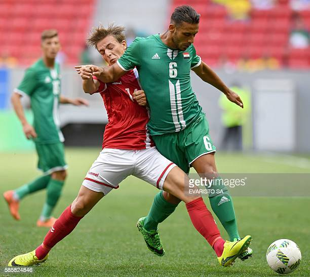 Iraq player Ali Adnan vies for the ball with Denmark player Lasse Vibe during their Rio 2016 Olympic Games First Round Group A men's football match...