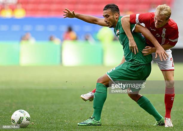 Iraq player Ali Adnan vies for the ball with Denmark player Mikkel Desler during their Rio 2016 Olympic Games First Round Group A men's football...
