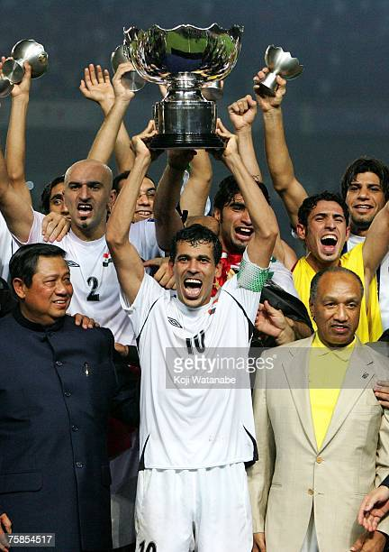 Iraq players celebrate winning the AFC Asian Cup 2007 final between Iraq and Saudi Arabia at Gelora Bung Karno Stadium on July 29 2007 in Jakarta...