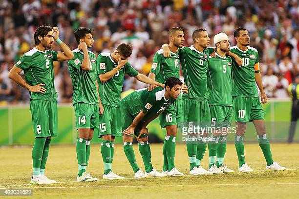 Iraq players watch on during the penalty shoot out during the 2015 Asian Cup match between Iran and Iraq at Canberra Stadium on January 23 2015 in...