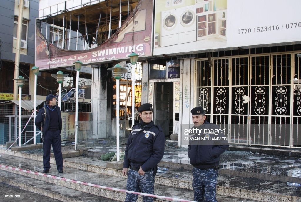 Iraq police stand in front of a burnt out building affiliated to the University of Sulaimaniyah, in the northern mainly Kurdish region of Iraq, on February 4, 2013, killing two students and a guard and wounding six others. The fire was believed to have started due to an electrical fault.