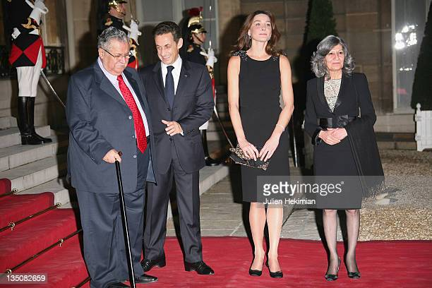 LR Iraq president Jalil Talabani French president Nicolas Sarkozy Carla BruniSarkozy and Hero Talabani attend the dinner honoring Iraq President...