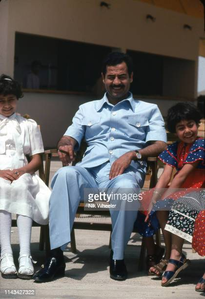 HABBANIYAH JANUARY 1977 Iraq president Saddam Hussein sits with his daughters Raghad and Rana at the lakeside holiday resort of Habbaniyah in Central...