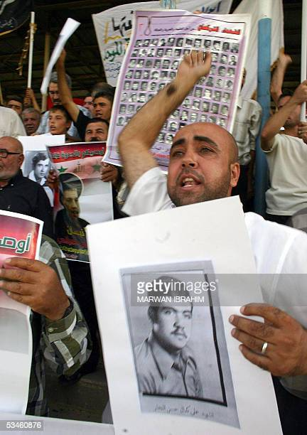 Shiite Muslim Turkmen protest holding photos of snuffed loved ones in the oil-rich city of Kirkuk, in northern Iraq 25 August 2005. The Turkmen want...
