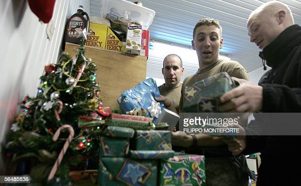 Soldiers of the 1st battalion 327th infantry regiment arrange gifts under the Christmas tree inside their base in the northern Iraqi city of Hawijah...