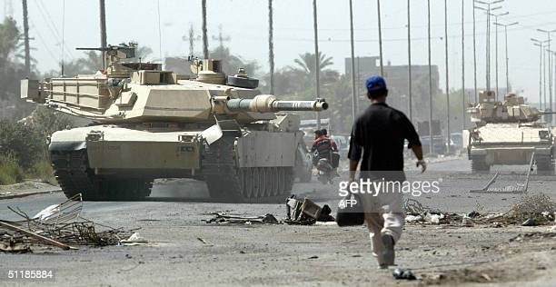 Soldiers with the US Army 1st Cavalry Division 1st Brigade 112 Cav from Fort Hood Texas patrol the streets in M1A1 Abrams tanks and Bradley fighting...