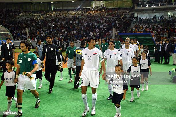 Iraq team and Saudi Arabia team line up for the start of the AFC Asian Cup 2007 final between Iraq and Saudi Arabia at Gelora Bung Karno Stadium on...