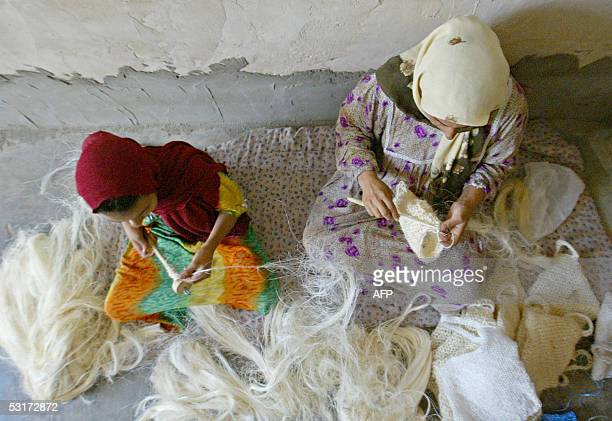 Twelve years old Afrah Abdel Razak weaves luffa fibers for her mother to knit and produce a hand made washing sponge at her home in alKhilani area in...