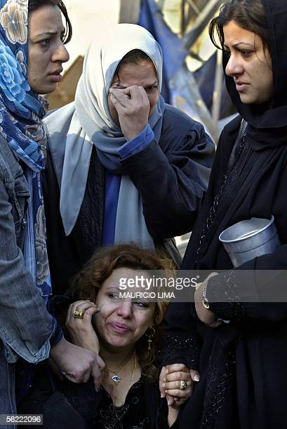 Two Iraqi wounded women cry at the site where two suicide bombers detonated explosivesladen cars near Al Hamra hotel that houses foreign journalists...