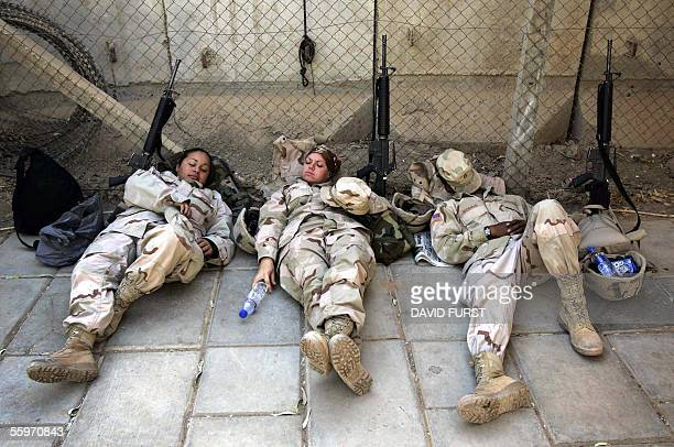 US army soldiers nap as they wait for transport in central Baghdad 20 October 2005 A senior lieutenant to AlQaeda's Iraq frontman Abu Musab alZarqawi...