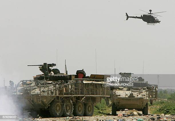 US Army Stryker armored vehicles from the 1st Battalion 5th Infantry patrol with the assistance of helicopters in the Palestine district in the city...