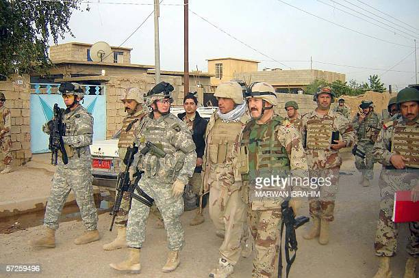 Colonel David Gray, Commander, 1st BCT, 101st Airborne Division , Iraqi Brigadier General Ayad and Major General Anwar Hama Amin tour a street in the...