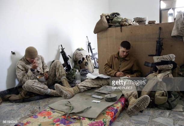 Marine, CPL Jacob Brinson and LCPL Derrick Lee , from Echo Company 2nd Battalion 2nd Marine Regiment, prepares battle plans for an upcoming patrol as...